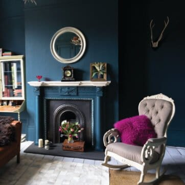 Paint Color Consultation for dark teal wall paint colors, black fireplace, taupe chair, hardwood floors and dark carpet.