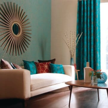 Paint color consultation for living room with green walls, white couch, wood floors and dark teal curtains.
