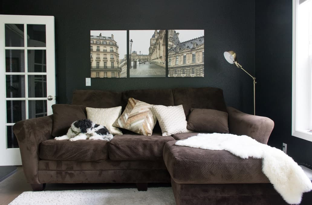 Den with Onyx 2133-10 walls, canvas prints of Paris and brown sofa.