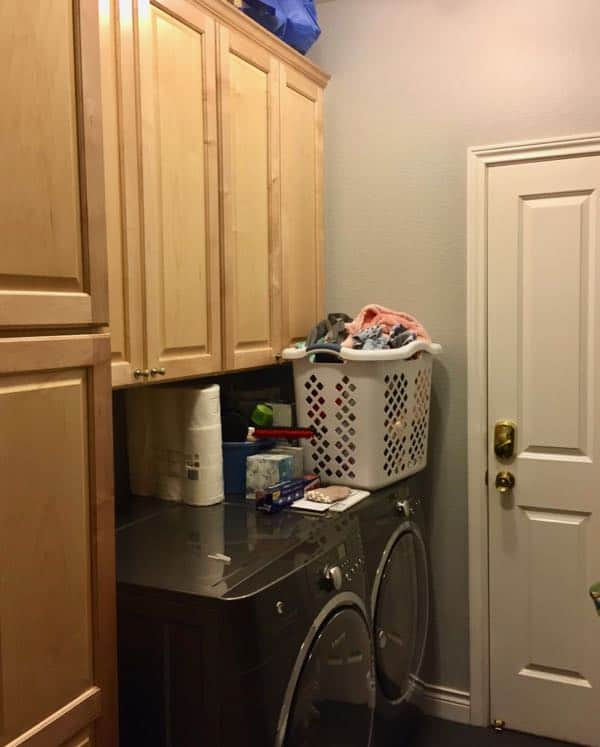 Laundry Room before with wood cabinets and gray walls.