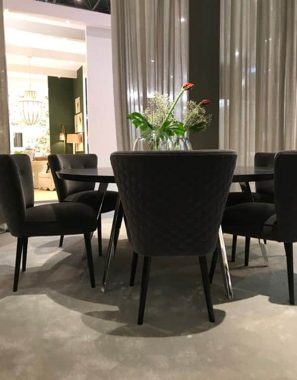 Van Roon Living Dining Room exhibit shows Black Chairs, Light Curtains and black walls
