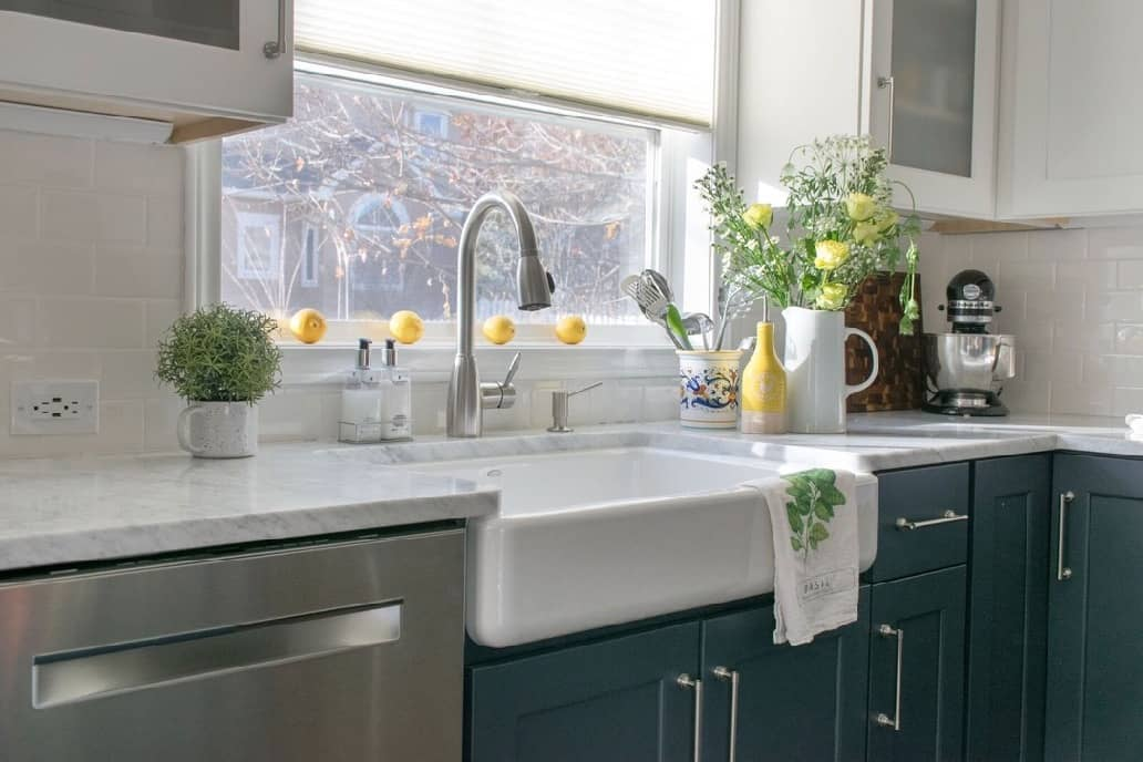 Farmhouse Sink styled with yellow accents in a kitchen remodel.