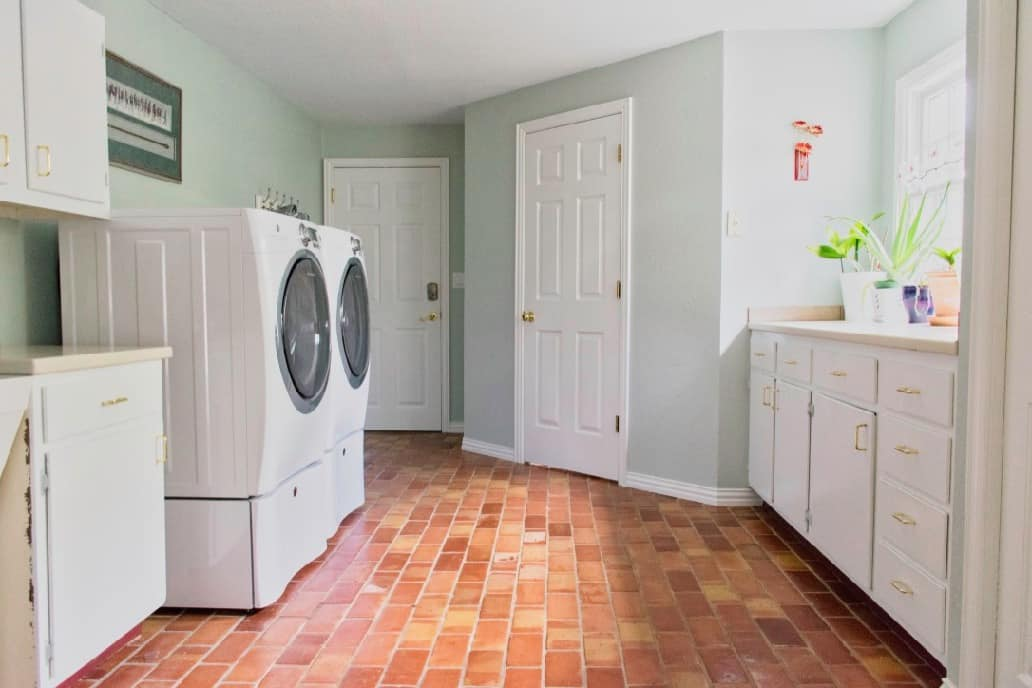 laundry room with washer and dryer and walls painted sw sea salt with trim, doors and cabinets painted sw extra white