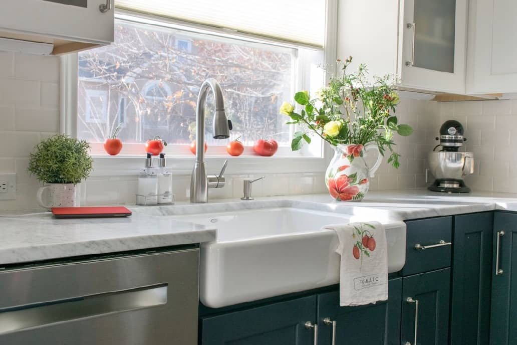 Koehler Whitehaven Farmhouse Sink Styled with red accents in a kitchen remodel