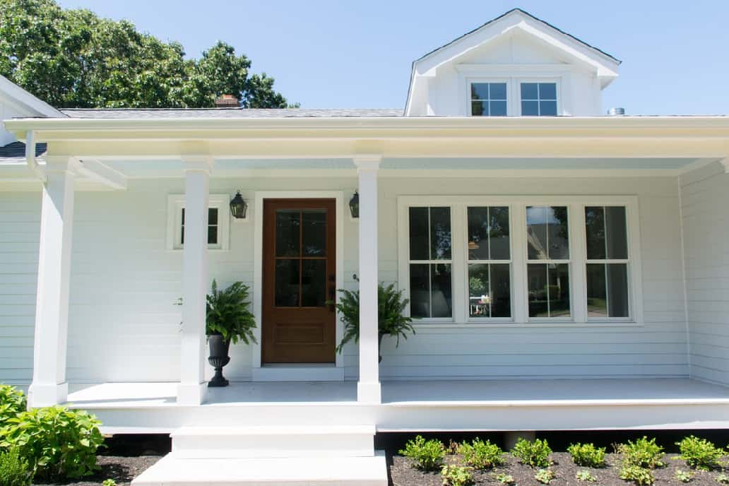 White coastal cottage with Beautiful front porch with haint blue ceiling and SW Zircon porch floor paint.