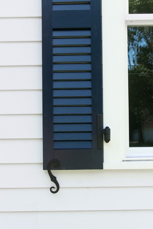Blue shutters with SW Extra White trim color, james hardie arctic white siding and SW extra white trim paint.