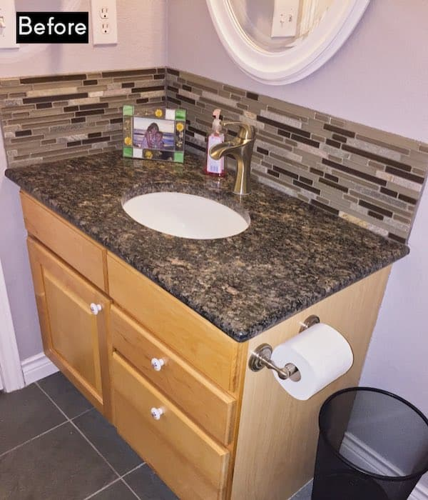 Before picture of vanity with backsplash and counter that don't match.