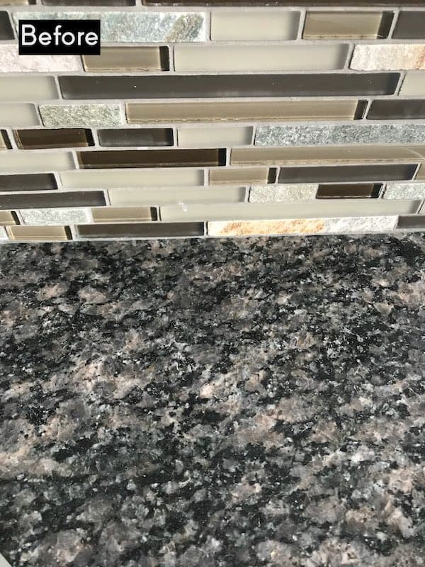 Before picture of granite counter and backsplash that don't match
