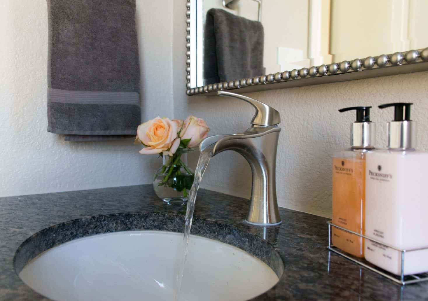 Powder room sink with peach roses and Jaida faucet