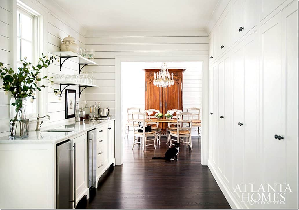 White butler's pantry with white shiplap and counters