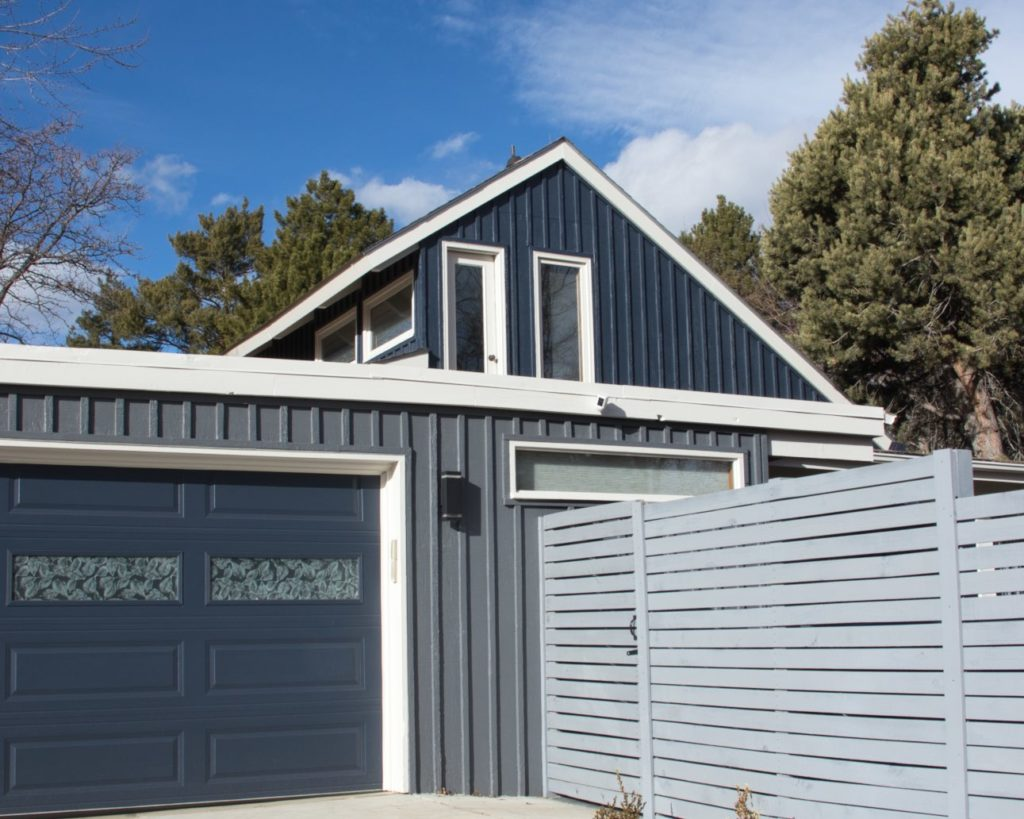 Mid-mod exterior painted with Hale Navy, Stormy Sky and Pale Oak