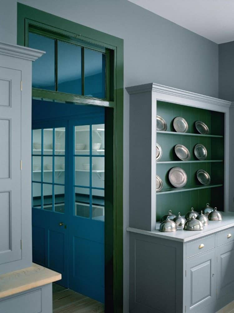 Blue and green butler's pantry with black counters