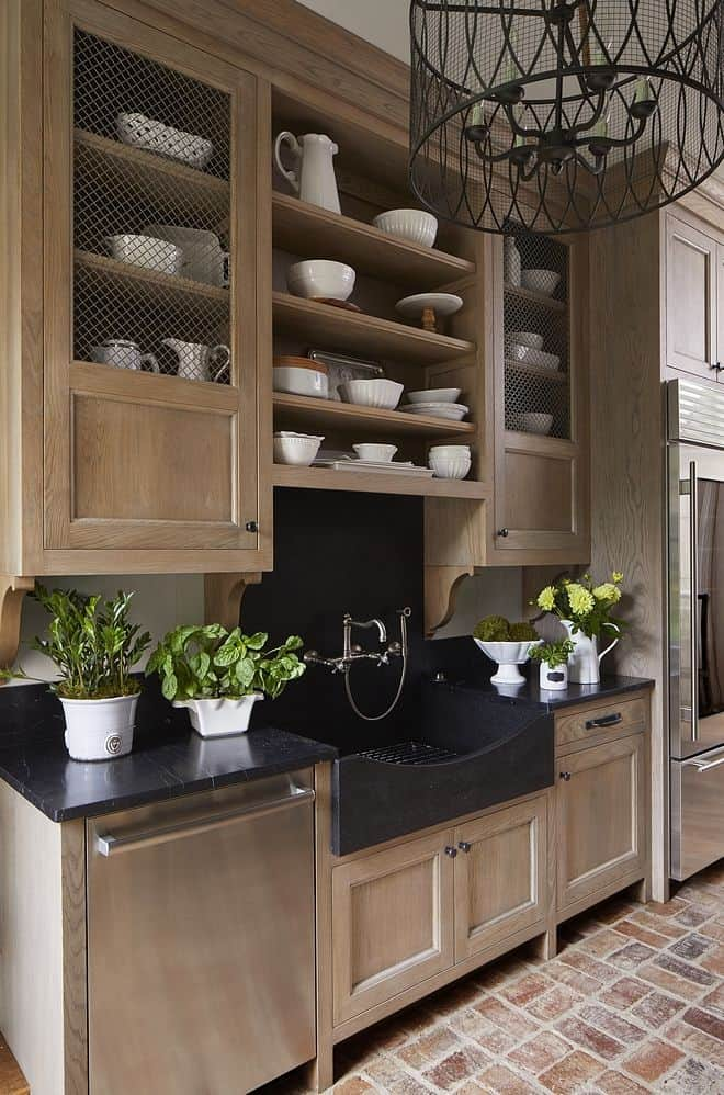 Butler's pantry with light Rift Oak Cabinets, Soapstone Counters, Rohl Faucet and brick floors