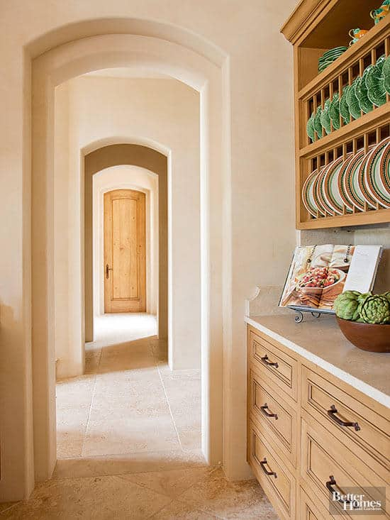Butler's pantry with light wood cabinets and white counters