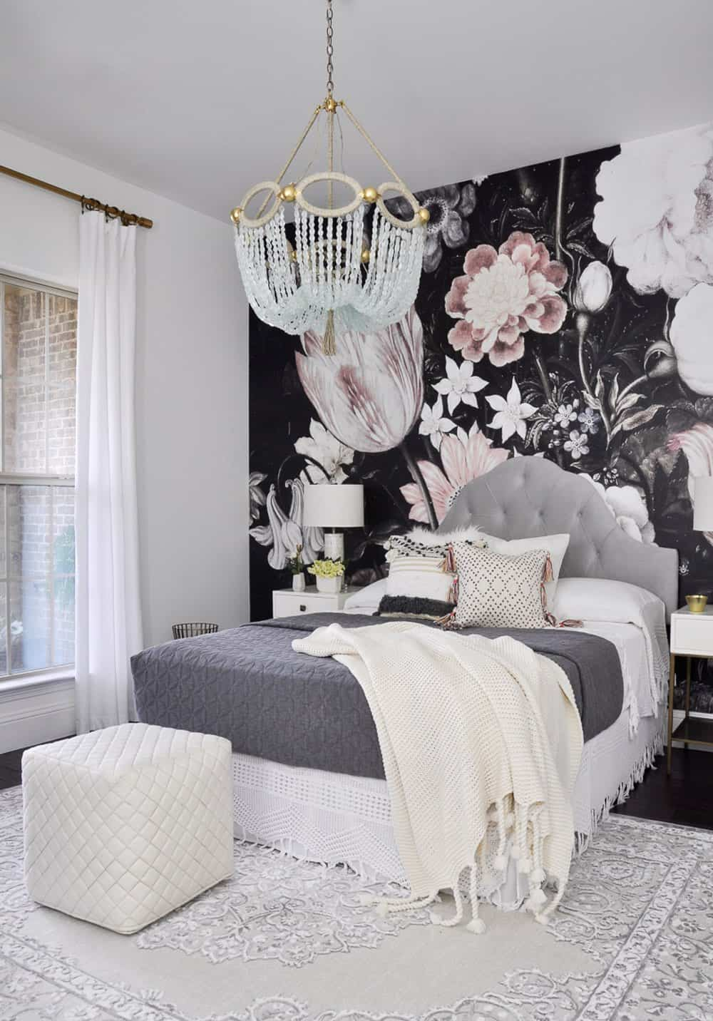 Bedroom with flowered wallpaper accent wall