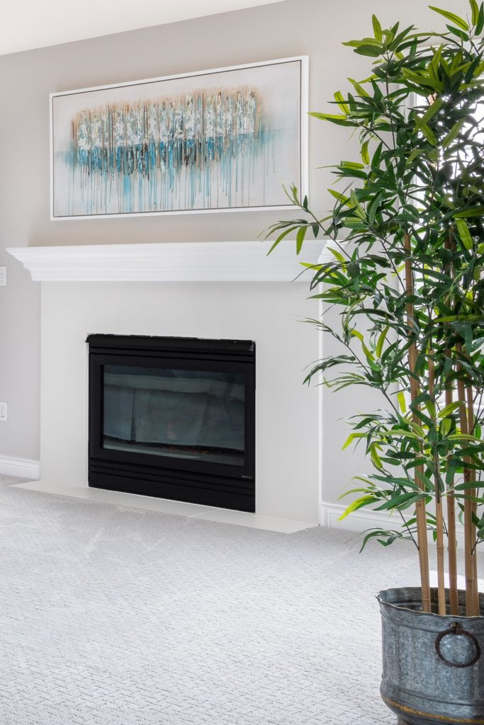 Classic fireplace mantle with white tile