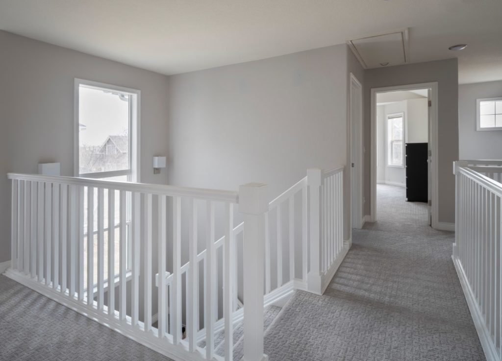 Landing with Gray walls and white stair railings