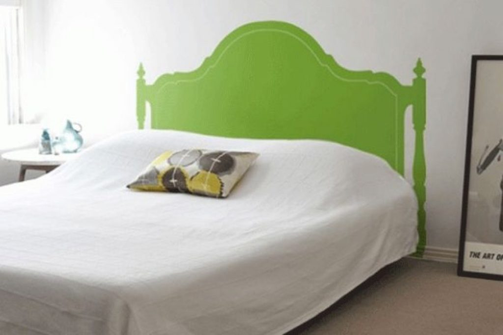 Bed with a wallpaper headboard