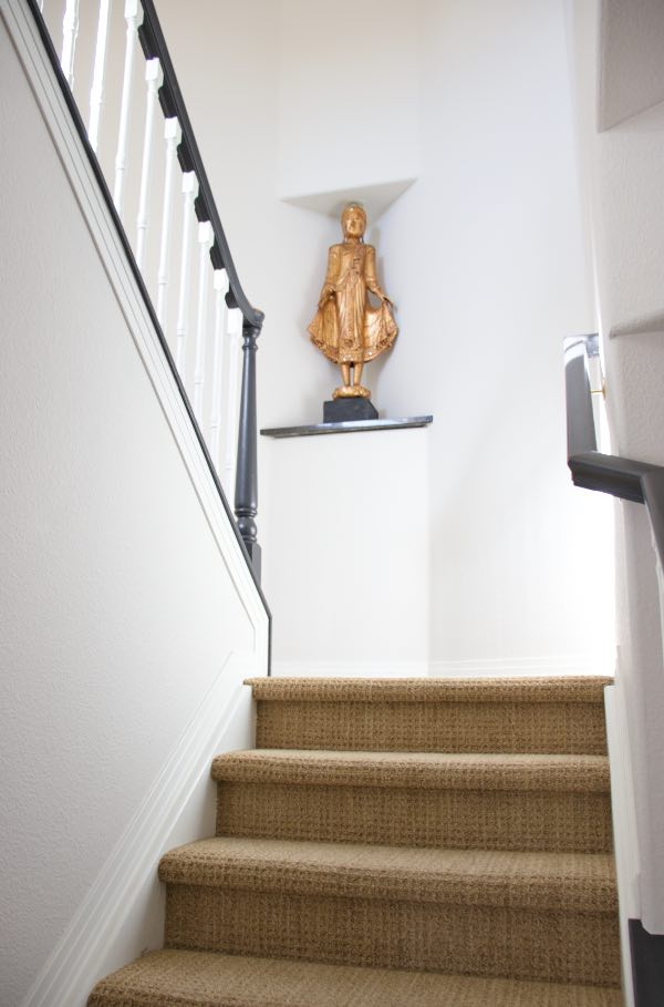 Classic Gray stairway with Simply white trim has buddha statue