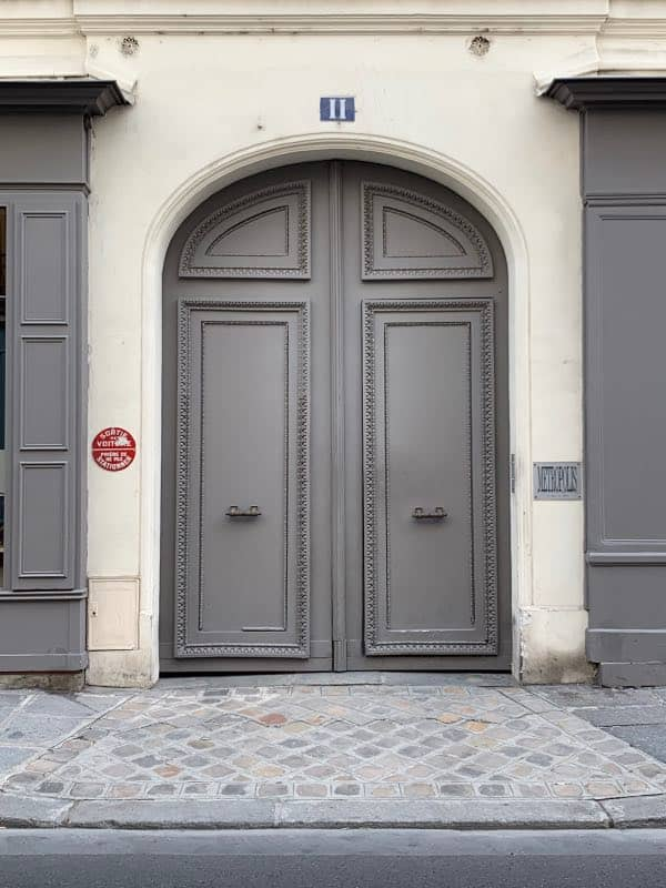 Gray front door painted with Benjamin Moore Sterling Silver 1461