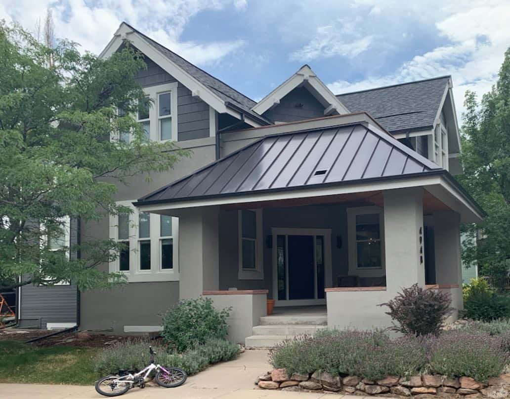 Classic house with front porch, Rockport Gray stucco, Kendall Charcoal siding and Classic Gray trim.
