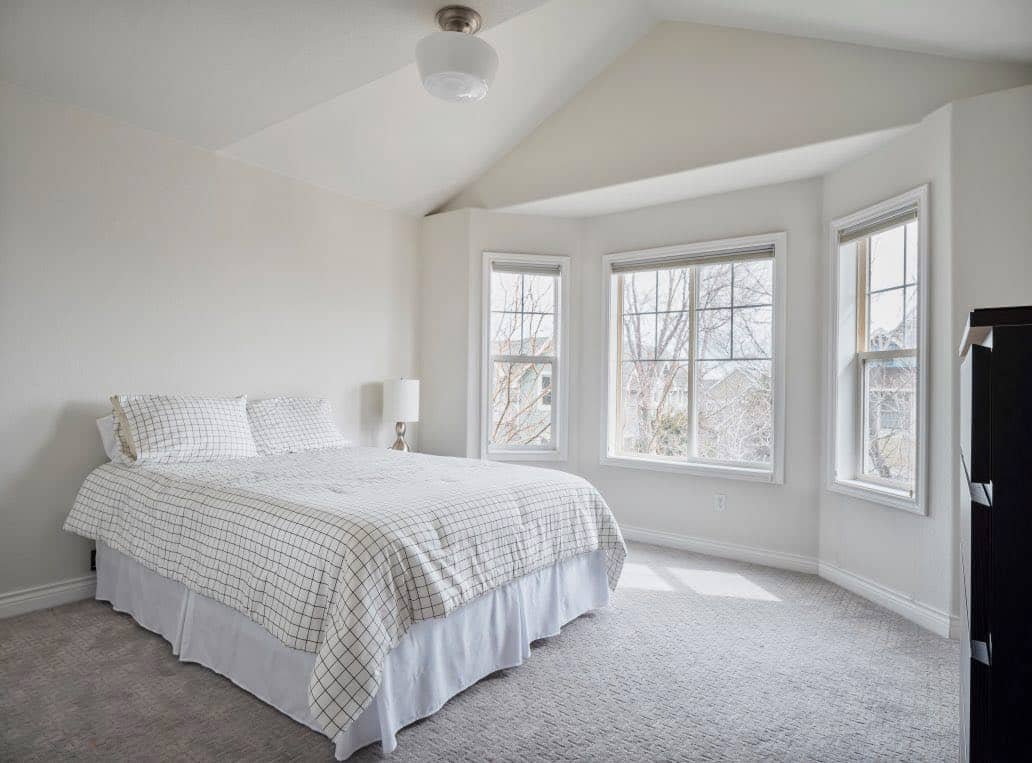 Bedroom painted with Classic Gray wall and ceilings and Chantilly Lace trim