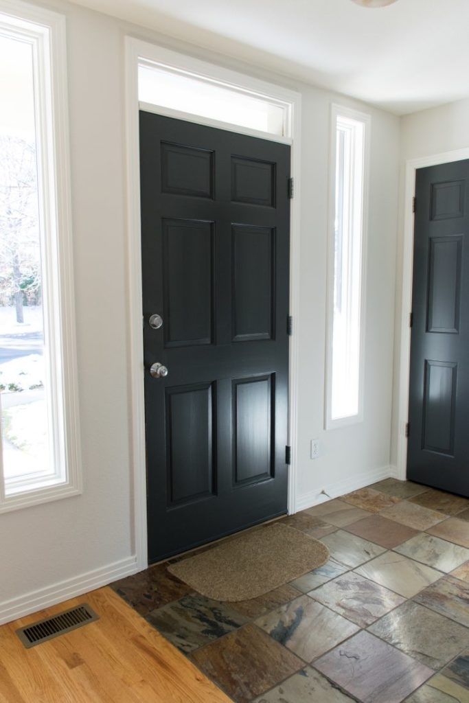 Entry walls with Classic Gray white paint and BM Wrought Iron black paint door.