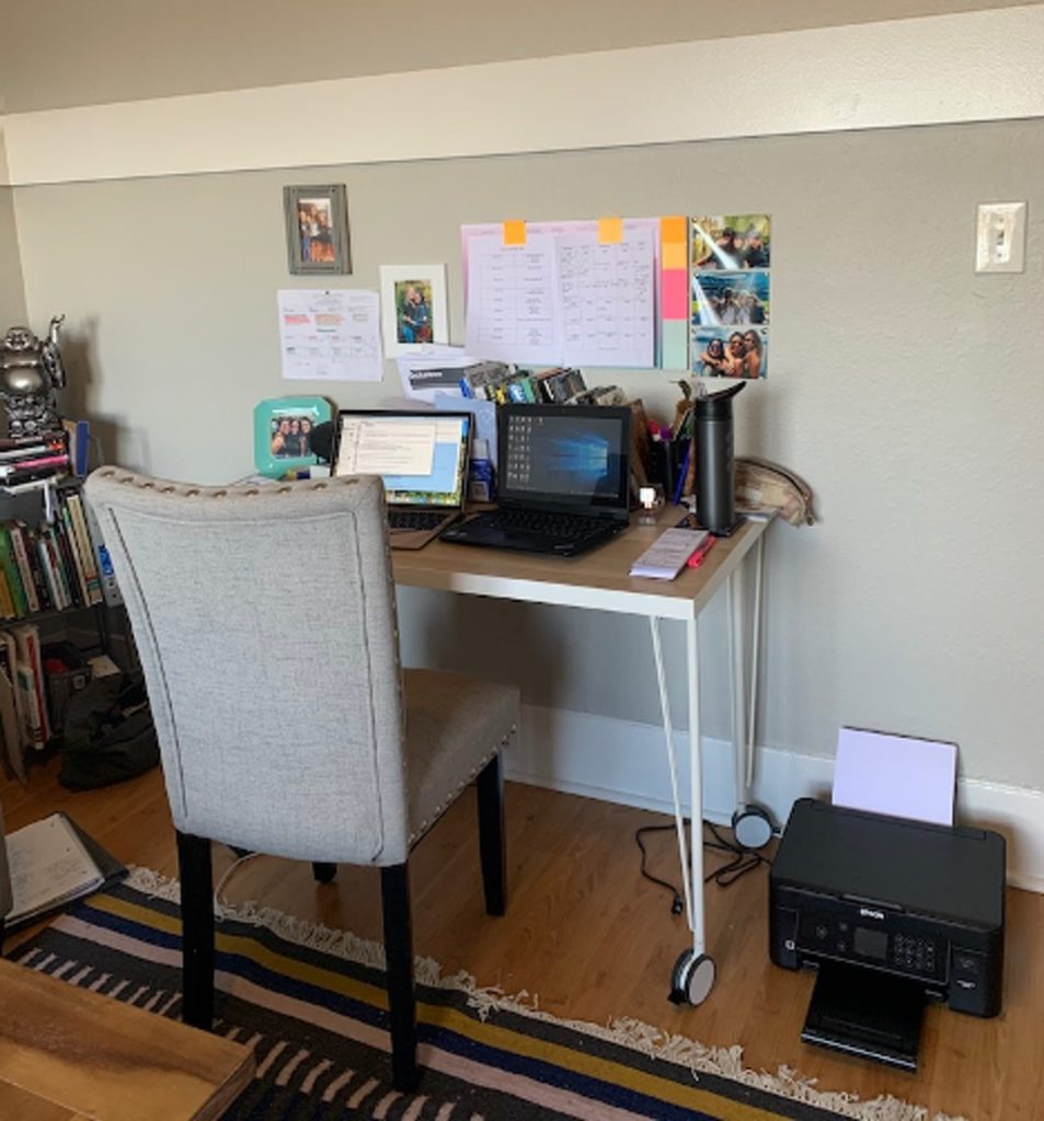 Home office with gray chair, white desk and walls painted Benjamin Moore Abalone