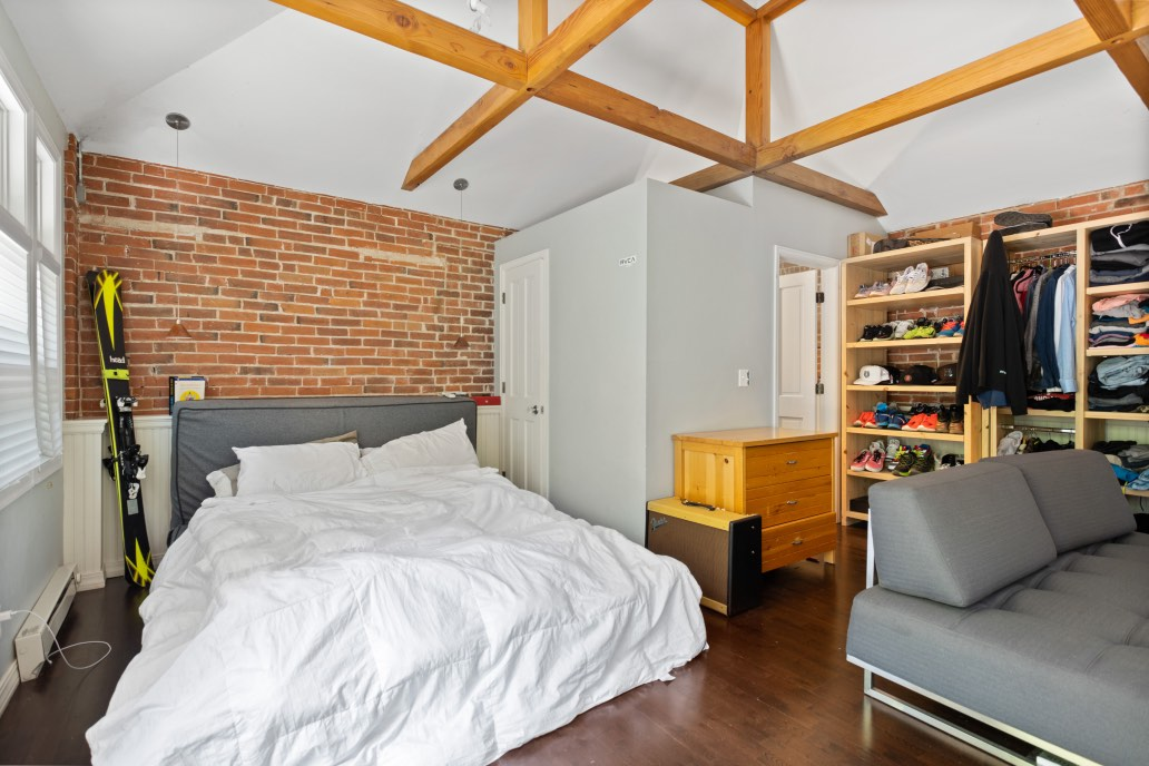 Bedroom painted with Shoreline walls and brick accent wall.
