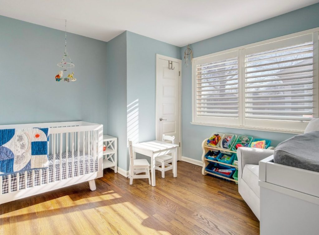 Boy's blue nursery painted with Benjamin Moore Smoke.