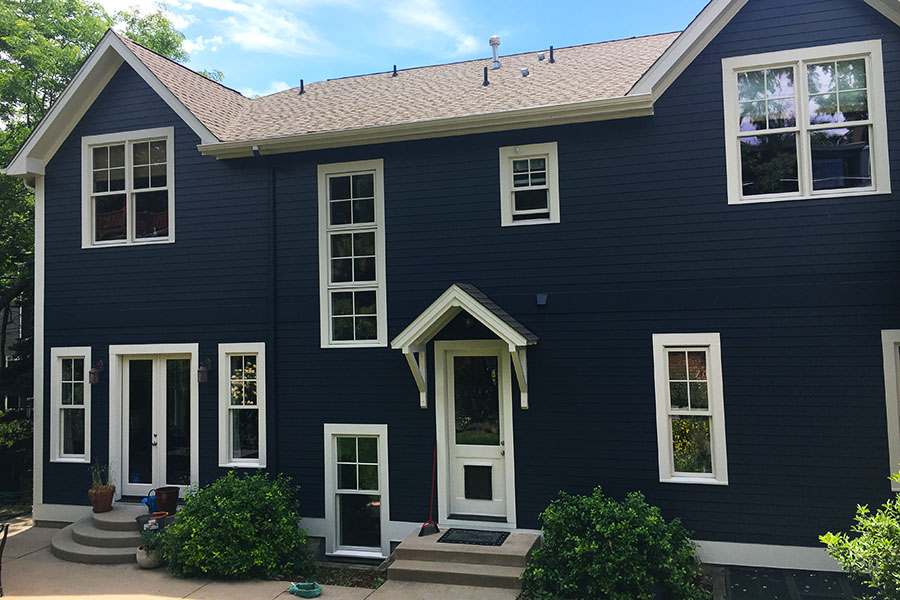 Blue house with white trim and white back door