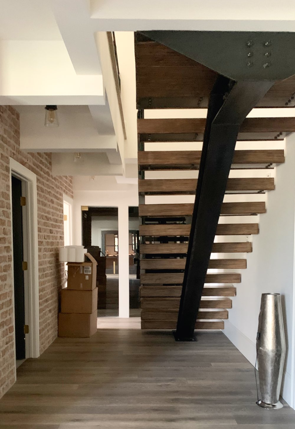 Cloud white walls in basement under stairs