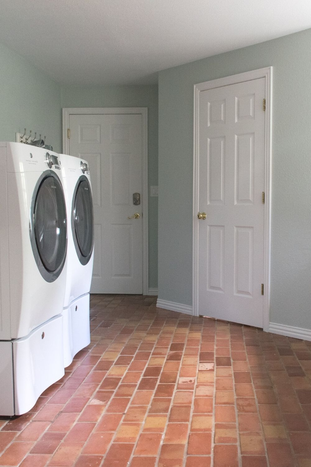 Laundry room with SW Sea Salt walls and terra cotta floors
