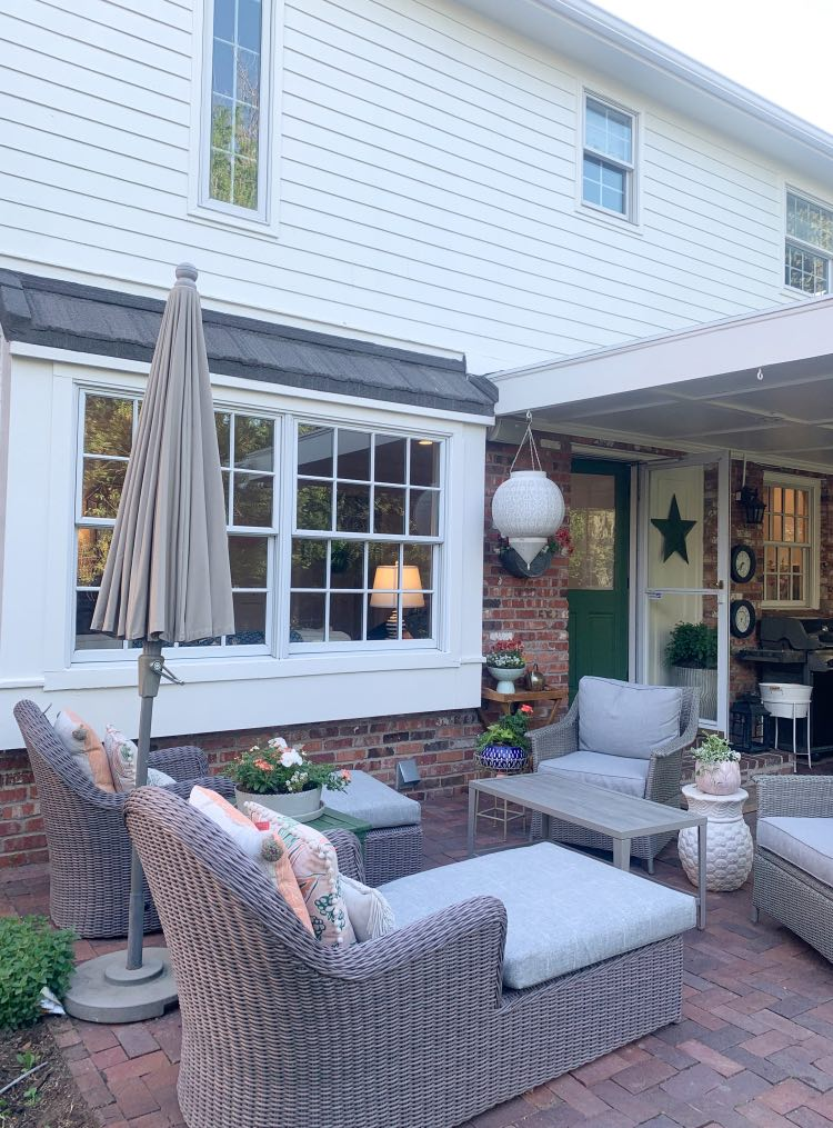 Red brick patio with outdoor living room and SW Greek Villa paint