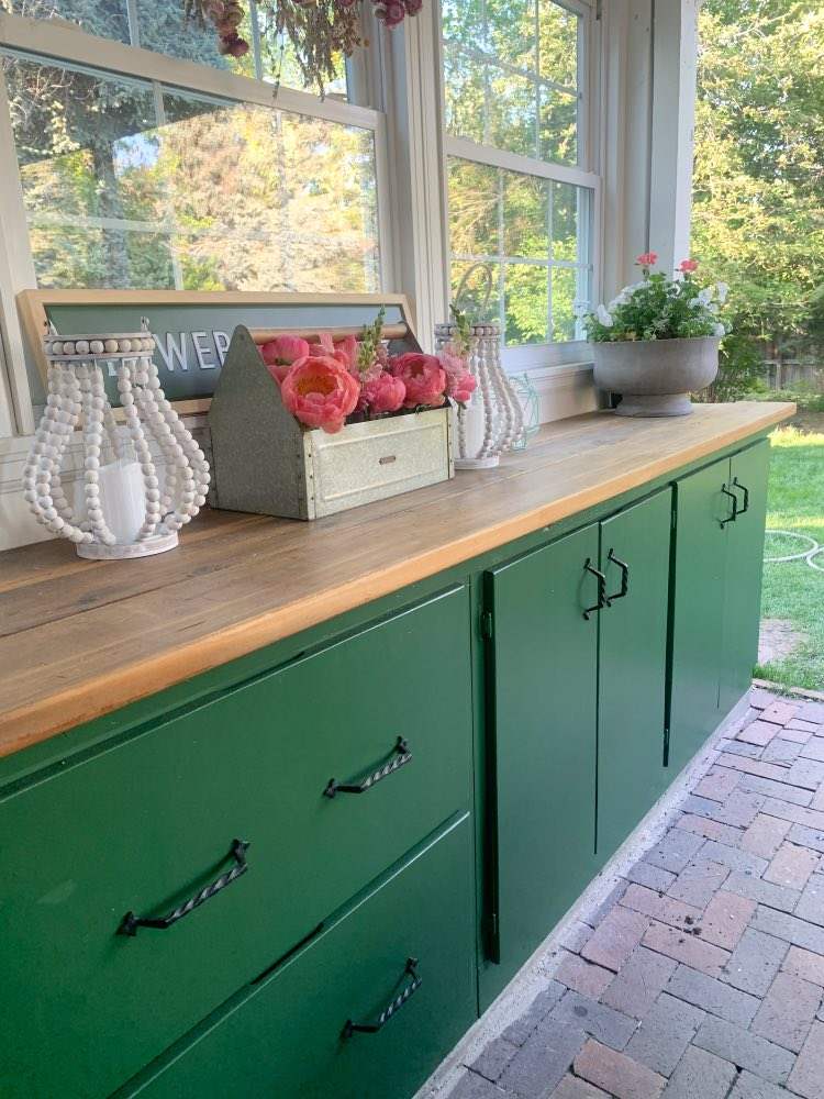 Back porch with green SW Courtyard cabinets