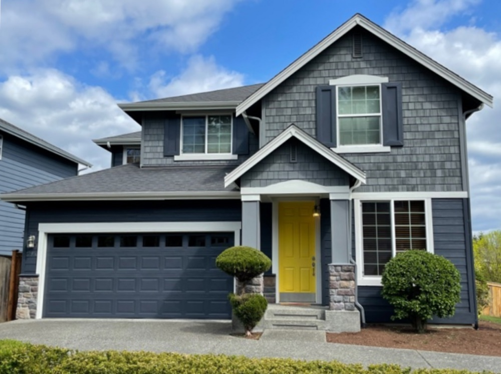 House with gray roof, SW Cyberspace siding, garage door and shutters with SW Westchester Gray shingles.