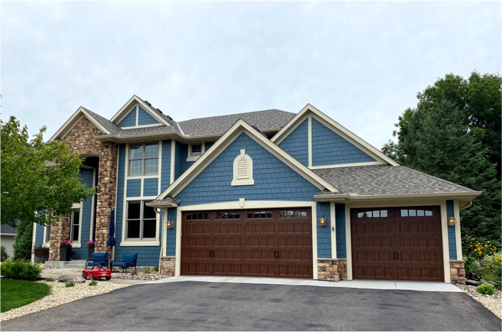 House with gray roof, SW Outerspace siding, wood garage door and white trim.